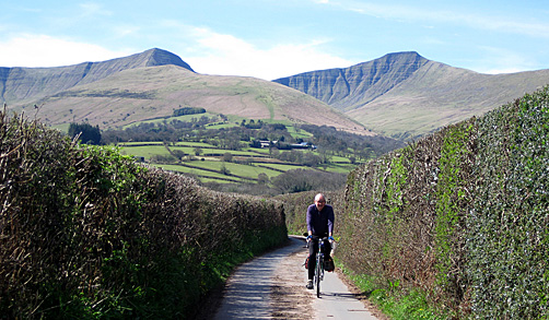 Cycling under Pen-y-Fan in the Brecon Beacons National Park, Wales
