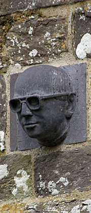 Head sculpture on wall