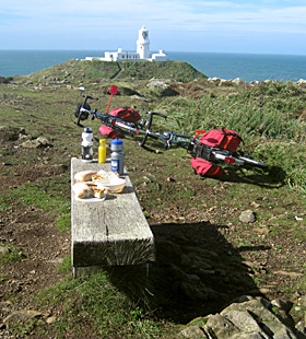 Cycling picnic lunch at Strumble Head lighthouse, Pembrokeshire